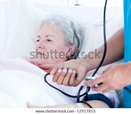 Sick senior woman lying on a hospital bed. Medical concept. - stock photo