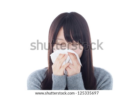 Sick woman blowing her nose isolated on white background - stock photo