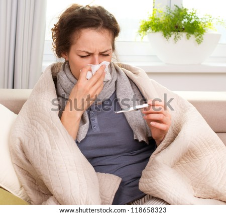 Sick Woman.Flu.Woman Caught Cold. Sneezing into Tissue. Headache. Virus - stock photo