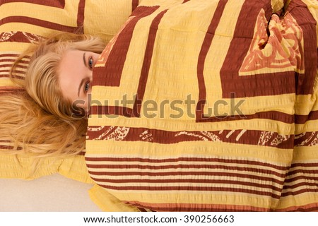 Sick woman lying in bed covered with blanket, feeling ill, has flu and fever. - stock photo