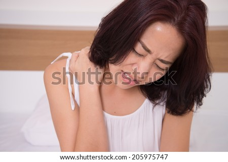 sick woman on bed concept of  suffering from neck pain - stock photo