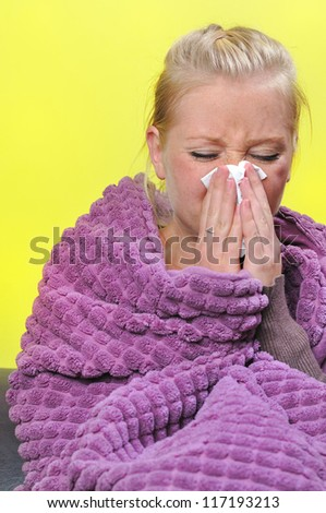 Sick woman with a flu, sneezing. - stock photo