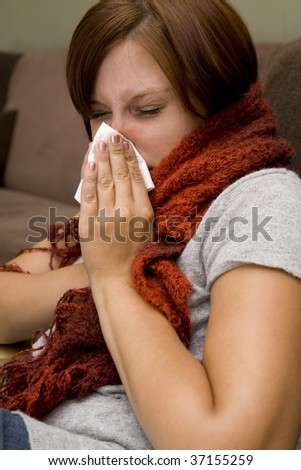 Sick woman with a lot of tissues - stock photo