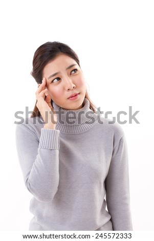 sick woman with one-side headache migraine, winter clothing studio shot - stock photo
