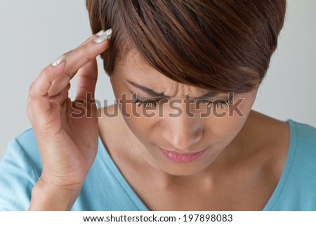 sick woman with pain, headache, migraine, stress, insomnia, hangover in casual dress, hand holding head, front view closeup - stock photo
