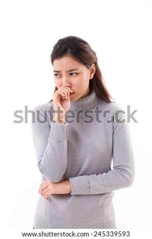 sick woman with runny nose due to cold weather - stock photo