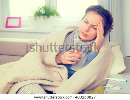 Sick Woman with Thermometer. Allergy reaction. Flu.Woman Caught Cold. Sneezing into Tissue. Headache. Virus. Flue - stock photo
