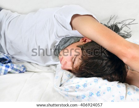 Sick Young Man sleep on the Bed - stock photo