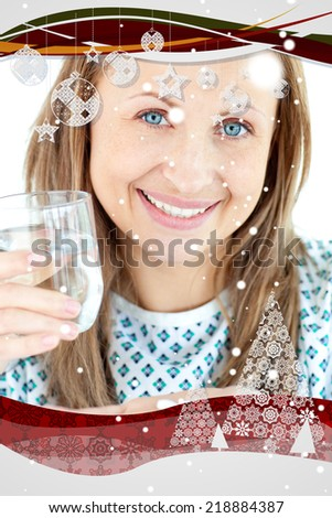 Sick young woman holding a glass of water and pills against snow falling - stock photo