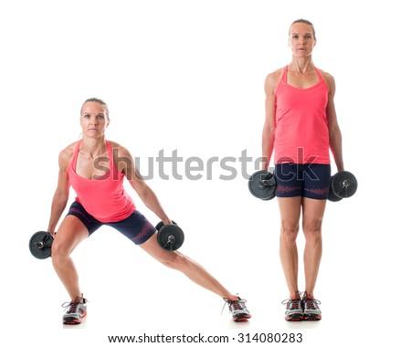 Side lunge exercise. Studio shot over white. - stock photo
