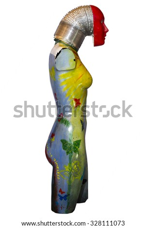 side of an multi colored artistic painted female mannequin torso with clipping path - stock photo