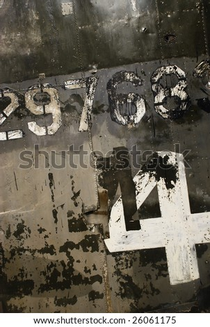 Side of old grungy military aircraft. - stock photo