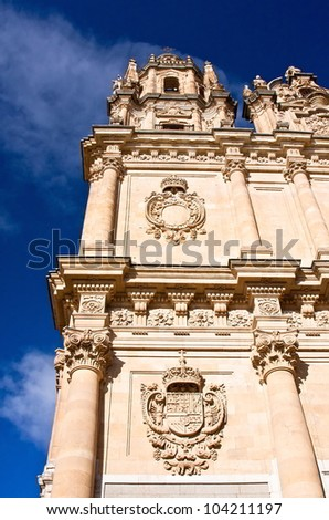 Side of the Pontifical University of Salamanca on blue sky - stock photo