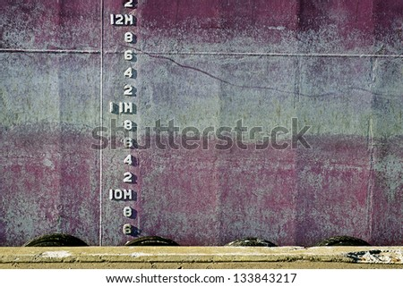 Side of the ship with depth numbers - stock photo