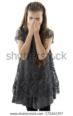 Side portrait of a beautiful girl crying and covering her face isolated on white - stock photo