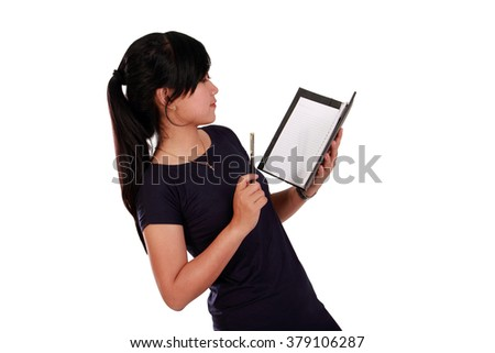 Side portrait of Asian girl reading from a notebook with serious face, isolated on white background - stock photo