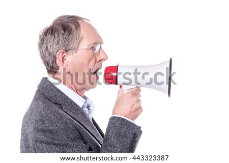 Side pose of old man making announcement in mega phone. - stock photo