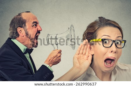 Side profile angry man screaming in megaphone curious nosy woman listening  isolated on wall background. Negative face expression emotion feeling. Propaganda breaking news social media power concept - stock photo