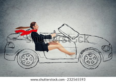 Side profile attractive woman driving car - stock photo