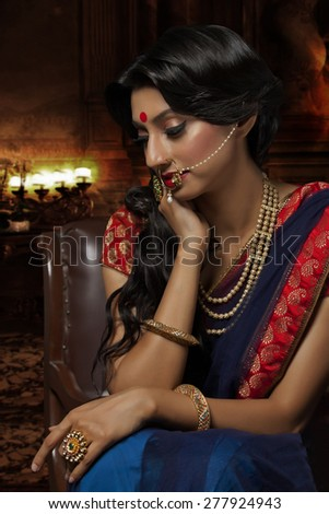 Side profile of a beautiful bride with jewelery - stock photo