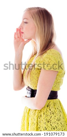 Side profile of a young woman whispering - stock photo