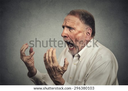 Side profile portrait of senior angry man - stock photo