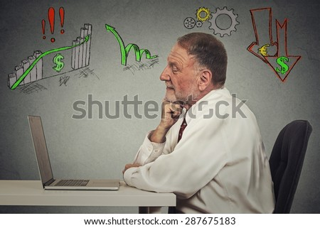 Side profile view senior business man working on computer isolated on grey wall background. Anticipation of financial crisis, bad, poor economy concept. Corporate employee thinking, making decisions. - stock photo