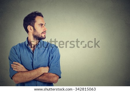 Side profile young man looking at his side - stock photo