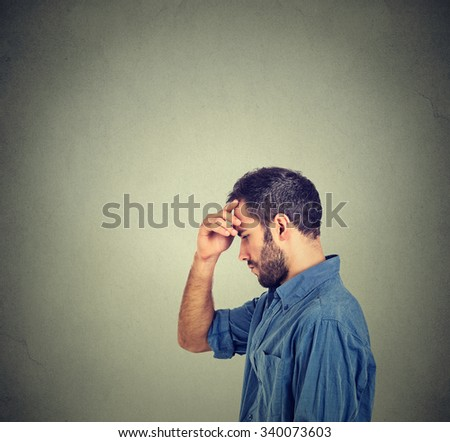 Side profile young thoughtful man isolated on gray wall background with copy space   - stock photo