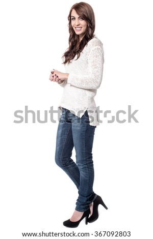 Side shot of pretty woman in casuals - stock photo