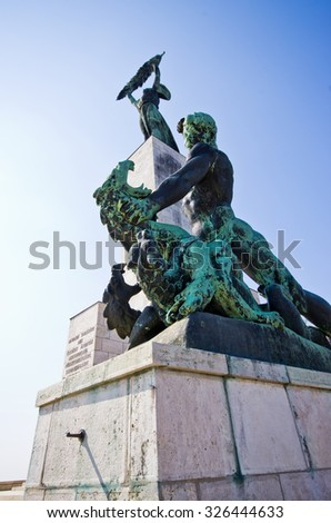Side statue of the liberty statue on Gellert hill in Budapest, Hungary - stock photo