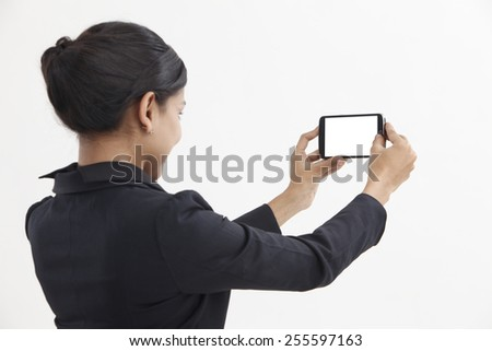 Side view business woman self portrait with smart phone - stock photo