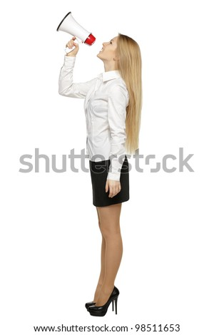 Side view full length of young business woman with megaphone, over white background - stock photo