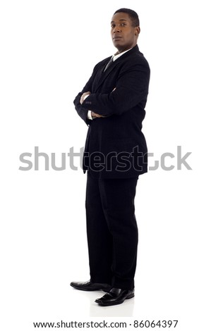Side view of a confident African American businessman standing with his hands crossed isolated white background - stock photo