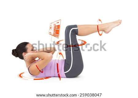 Side view of a fit young woman doing crunches against fitness interface - stock photo