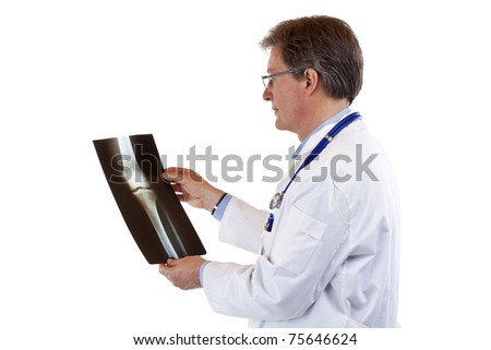 Side view of a Friendly elderly doctor studying radiogram. Isolated on white background. - stock photo
