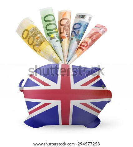 Side view of a piggy bank with the flag design of United Kingdom and various european banknotes.(series) - stock photo