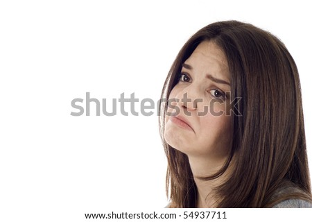 Side view of a sad woman isolated over white background, a lot of copyspace. - stock photo