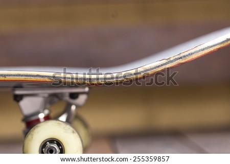 Side view of a skateboard - stock photo