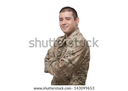 Side view of a soldier with arms crossed  - stock photo