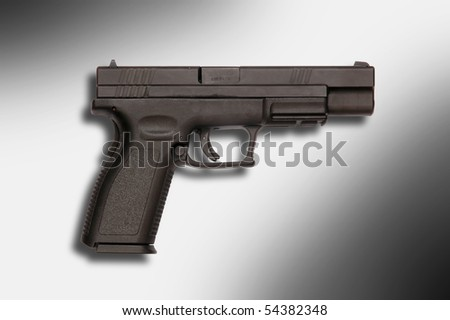 Side view of a Springfield semiautomatic pistol - stock photo