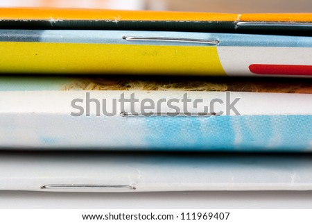 Side view of a stack of magazines - stock photo