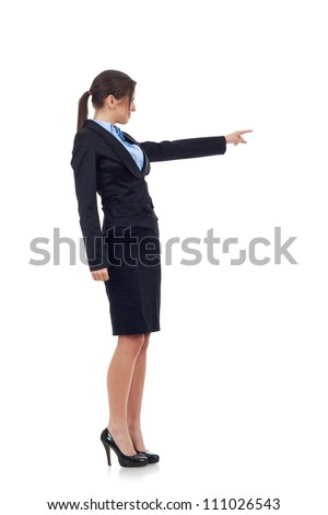 Side view of a young business woman pointing with left hand over a white background - stock photo