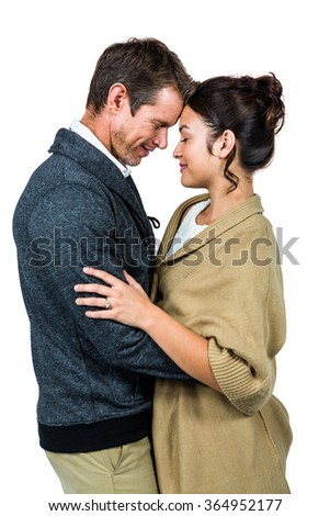 Side view of affectionate couple hugging against white background - stock photo
