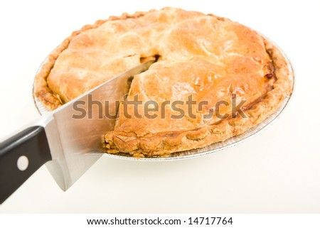 Side view of an apple pie being cut. - stock photo