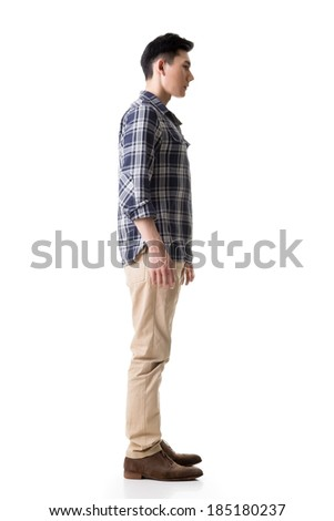 Side view of Asian young man, full length portrait isolated on white. - stock photo