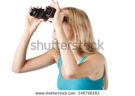 Side view of  blond woman looking through binoculars - stock photo