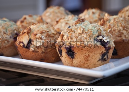 Side view of blueberry muffins topped with cinnamon granola - stock photo