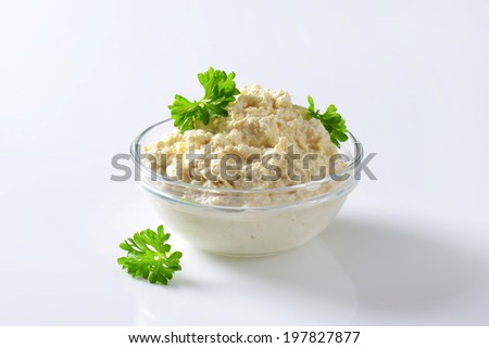 side view of bowl with breakfast cheese spread - stock photo