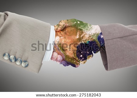 Side view of business peoples hands shaking against grey vignette - stock photo